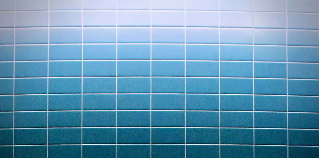 Close up photo of blue tiled wall